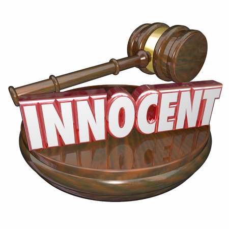 defendant: Innocent word in red 3d letters on a wood judge gavel and block to announce a final verdict or decision finding a defendant not guilty Stock Photo