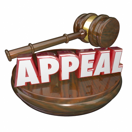 appeals: Appeal word in 3d red letters on a wooden judge gavel to illustrate a request for retrial of court case