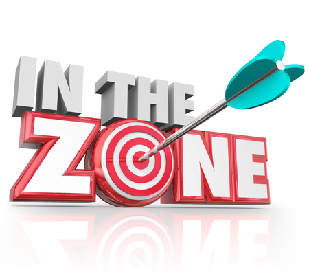 hitting: In the Zone words in 3d red letters and an arrow hitting the bulls-eye target to illustrate hitting your stride or on a winning streak
