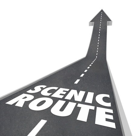 delaying: Scenic Route words in 3d letters on a road to illustrate the longer, more enjoyable way to travel or drive