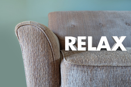 upholster: Relax word in white 3d letters on a couch to illustrate desire to take a break and rest on plush furniture