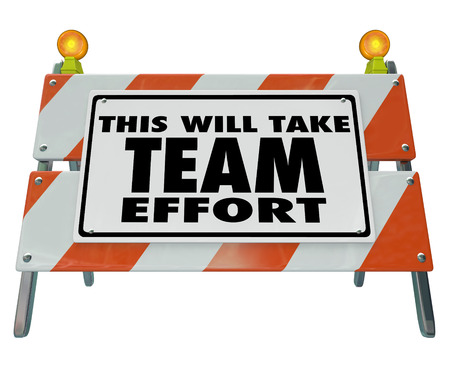 This Will Take Team Effort words on a construction barrier or sign to warn of a difficult task, challenge, goal, project or job Banque d'images