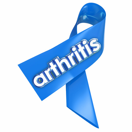 seniors suffering painful illness: Arthritis word on a blue awareness ribbon to illustrate fund raising and research to find a cure to the painful condition or disease