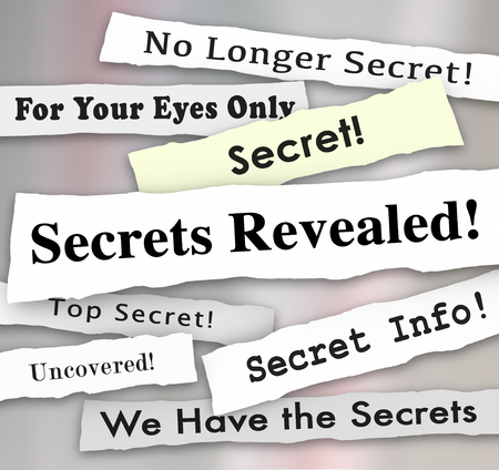 reveal: Secrets Revealed words on newspaper headlines to illustrate a confidential or classified announcement, update, unvelied or revealed communication