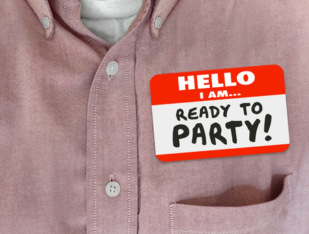 my name is: Hello I Am Ready to Party words on a name tag worn by person in pink button shirt Stock Photo