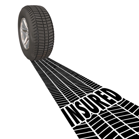 insured: Insured word in tire tracks behind a wheel to illustrate insurance coverage, policy and protection