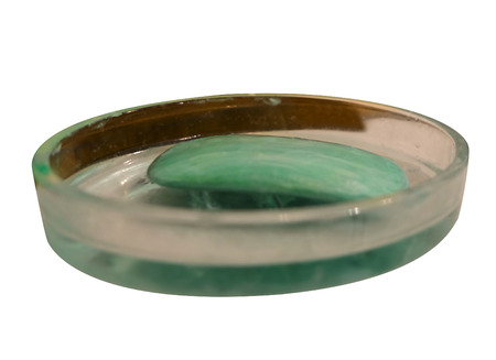 cleansed: Soap in dish on a tub ledge telling you to wash up and get cleansed for hygiene and good health isolated