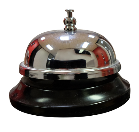front desk: Service counter a bell to call for help or assistance at a front desk isolated