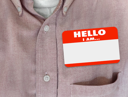 meet and greet: Hello I Am blank name tag worn by person in red button shirt