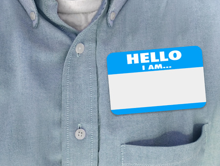 blank tag: Hello I Am blank name tag worn by person in blue button shirt
