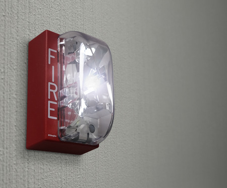 rehearse: Fire alarm as a light or siren goes off in an emergency trial run to be prepared and ready for real crisis