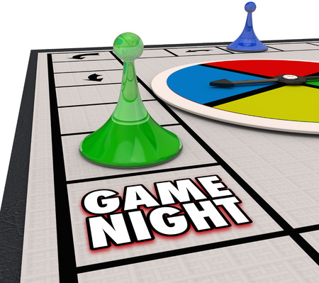 Game Night words on a board game with pieces moving around in fun competition Zdjęcie Seryjne - 48338287