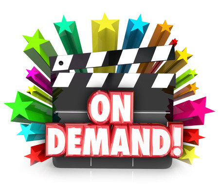 vod: Video On Demand or VOD on a movie clapper board to illustrate streaming movies or films to watch or rent at home on television over cable or Internet Stock Photo