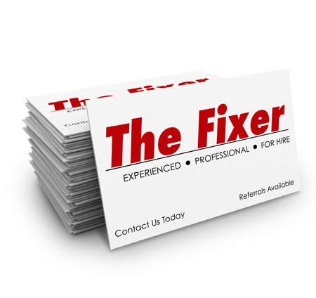 underworld: The Fixer words on a business card in stack or pile for a professional who can solve a problem or make trouble go away Stock Photo