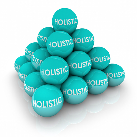 holistic health: Holistic words on balls in a pyramid to illustrate total, whole complete balance in life or health well-being