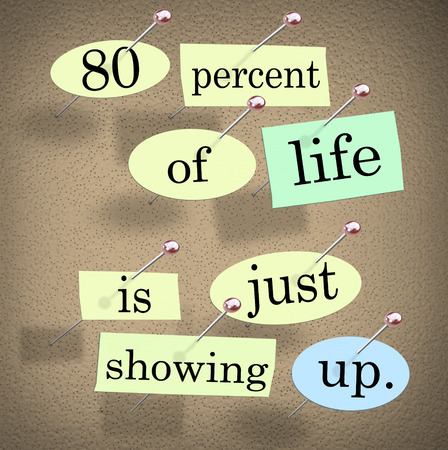 mundane: 80 percent of life is just showing up words pinned on a bulletin board Stock Photo