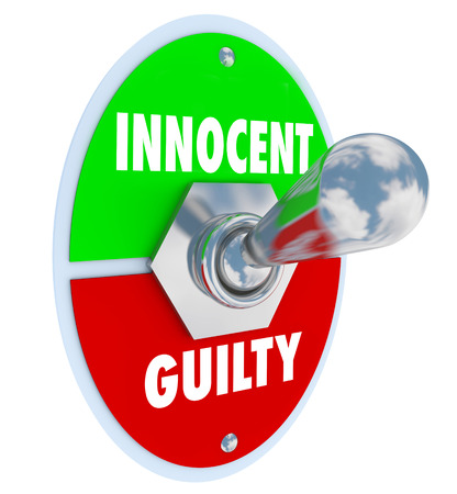 toggle switch: Innocent Vs Guilty words on a toggle switch to illustrate an acquital or conviction in a legal court case or trial