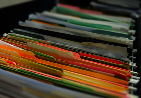 Backlog file folders to illustrate a long waiting list for your application or form to be processed in an inefficient system Archivio Fotografico