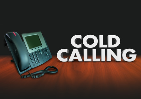 solicit: Cold Calling words in 3d letters beside a telephone to illustrate working a job in selling to customers over the phone Stock Photo