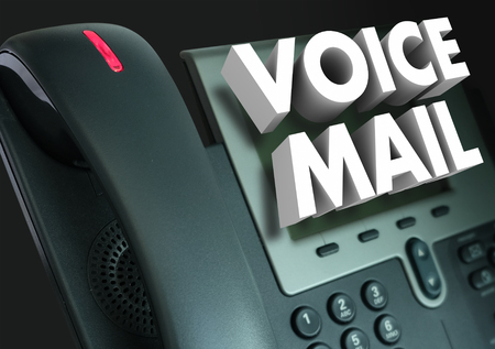 Voice Mail words in white 3d letters on a telephone to illustrate a recorded message or greeting Foto de archivo