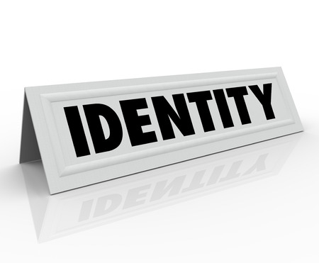 and distinctive: Identity word on a name tent card to illustrate your unique character or distinctive personality Stock Photo