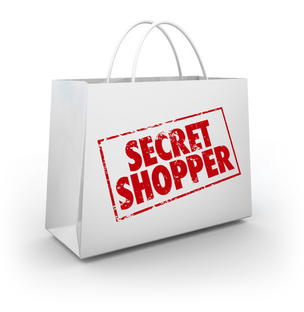 product reviews: Secret Shopper shopping bag to illustrate evaluation of a store from a mystery person rating or reviewing employee performance