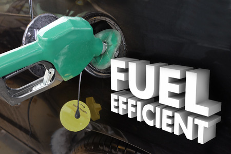 gas nozzle: Fuel Efficient 3d words on car as a green gas nozzle fills the tank with gasoline or ethanol based E85 additive Stock Photo