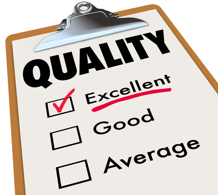to review: Quality word on a clipboard checklist to illustrate an excellent rating, grade or review Stock Photo
