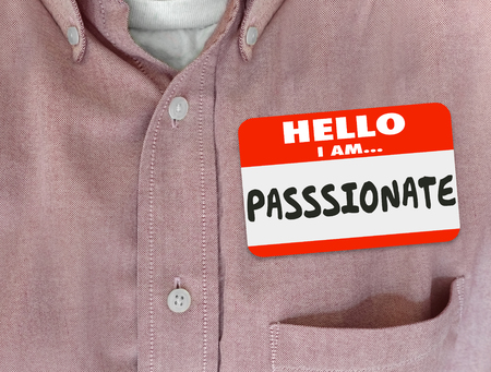 Passionate word on red nametag worn by an employee, worker or person who is eager, ambitious, active and dedicated Foto de archivo