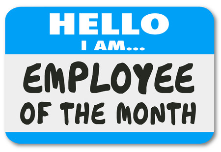 month: Employee of the Month on a Hello nametag sticker worn by the best or top worker or staff member