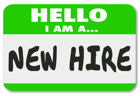 Hello I Am a New Hire words written on a green nametag sticker for a rookie employee or fresh talent just added to the team Foto de archivo