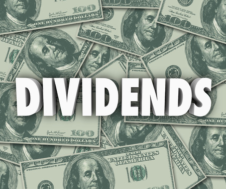 dividends: Dividends word in 3d letters on cash or money background to illustrate profits, revenue or income from stock market investments