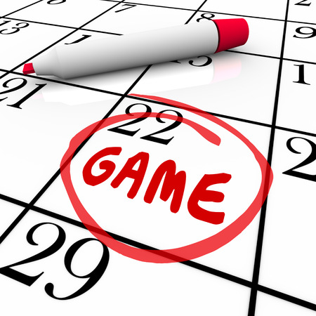 event calendar: Game day or date circled with red pen or marker on a calendar or schedule as a reminder of the big event or competition