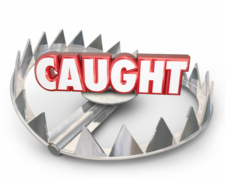 captured: Caught word on a steel bear trap to illustrate danger of being captured