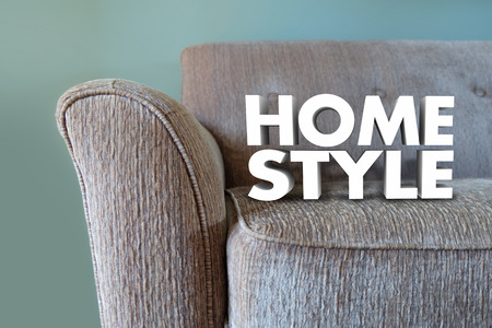 decor: Home Style words in white 3d letters on a couch or furniture to illustrate interior design or decor