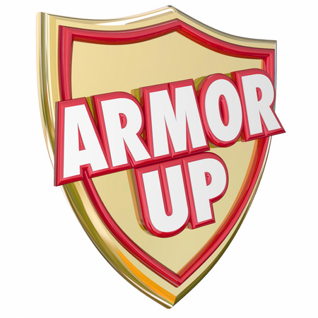 safeguarded: Armor Up words in 3d letters on a gold shield to illustrate protecting yourself from danger