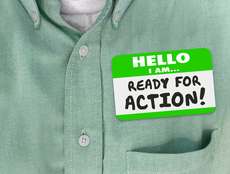eagerness: Hello I Am Ready for Action words written on green nametag sticker on a shirt of an employee or worker Stock Photo