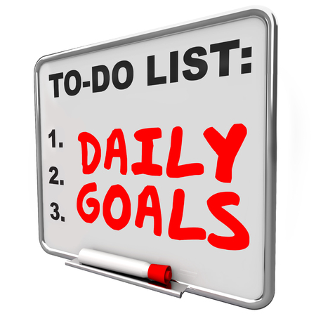 prioritizing: Daily Goals words written with red marker or pen on a to do list message board to prioritize jobs, tasks and work