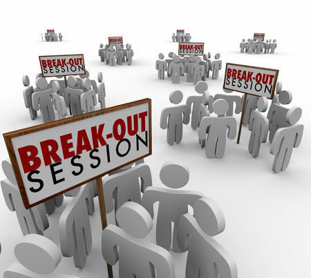 Break-Out Session words on signs with small groups of people gathered around them for seminar or workshop meetings or discussions Archivio Fotografico