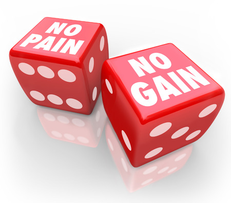 odds: No Pain No Gain words on two red dice to illustrate taking a chance or betting on your odds in winning over difficult odds or luck