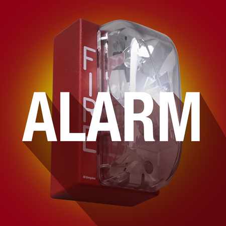Alarm word with long shadow on a fire elert for a crisis or emergency evacuation