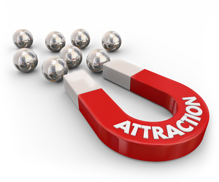 enticing: Attraction word on a red metal magnet pulling or drawing ball bearings close together