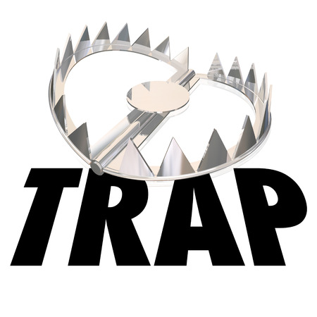 entrapment: Steel bear trap with metal teeth and word to illustrate or warn of risk or danger