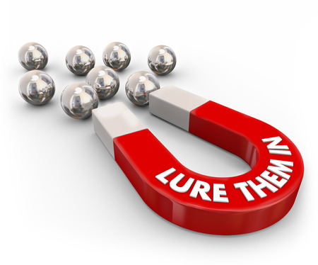 Lure Them In words on a red magnet to illustrate attracting customers or audience through tempting offer Stock Photo