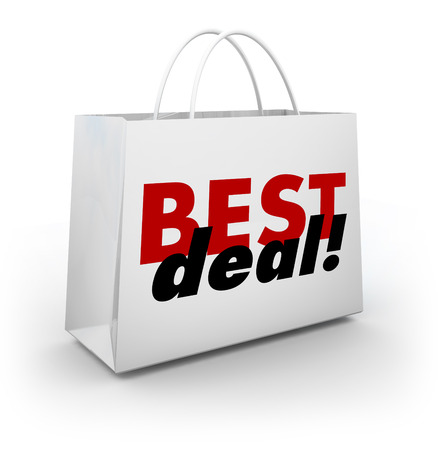 low prices: Best Deal words on a white store shopping bag having a big sale with discount low prices Stock Photo