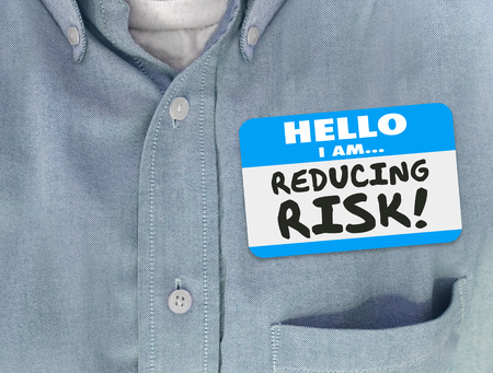 reduce: Hello I am Reducing Risk words written on a blue name tag on a worker or consultant in a shirt who is decreasing danger or liability to increase safety and security