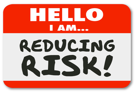 reduce: Hello I am Reducing Risk words written on a red name tag sticker to illustrate you engaged in danger mitigation or reduction