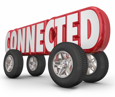 autonomous: Connected word in red 3d letters on wheels to illustrate a car, truck or other vehicle using autonomous, ADAS or web based services for driving convenience Stock Photo