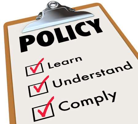 regulated: Policy word on a checklist clipboard for rules, regulations or laws with check boxes for learn, understand and comply