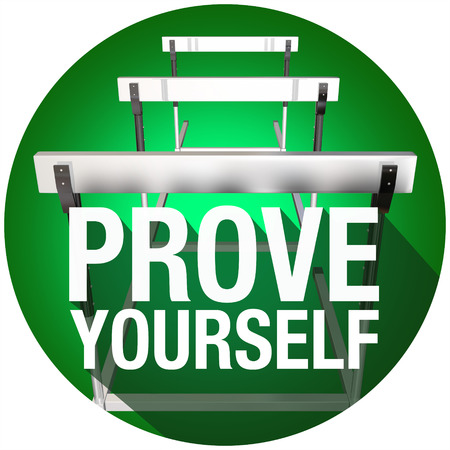 prove: Prove Yourself words over hurdles with long shadow to illustrate facing a challenge or obstacles with determination Stock Photo